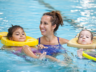 Children in pool with instructor